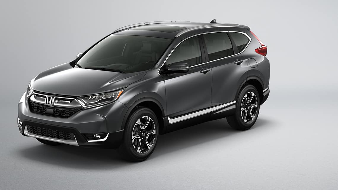 Front 3/4 view of 2019 Honda CR-V Touring in Gunmetal Metallic.